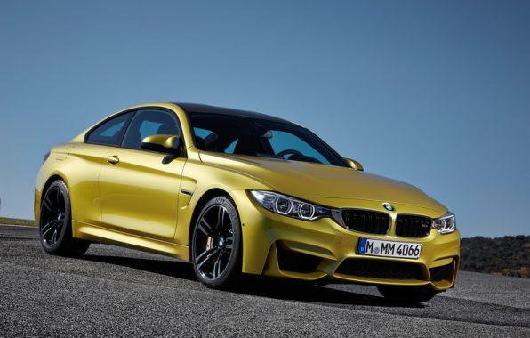 3/4 avant BMW M4 jaune