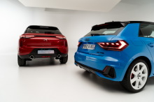 DS3 Crossback Performance Line Ruby Red and Audi A1 Sportback 2019 Blue Turbo Rear view in studio on white background