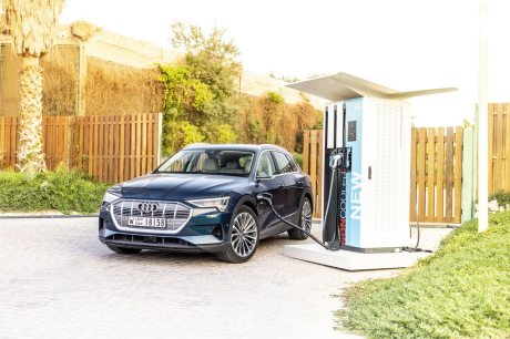 Audi e-tron blue front view with charging socket
