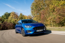 Ford Focus blue tracking shot