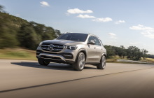 Mercedes GLE gray driving front left