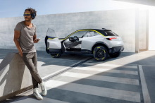 Opel GT X Experimental concept car SUV with electric profile, open doors in studio