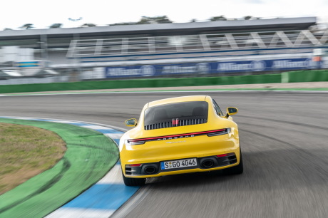 Porsche 911 992 2019 yellow track back on the slopes