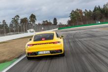 Porsche 911 992 2019 yellow during reverse braking