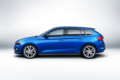 Blue profile view Skoda Scala in studio on white background